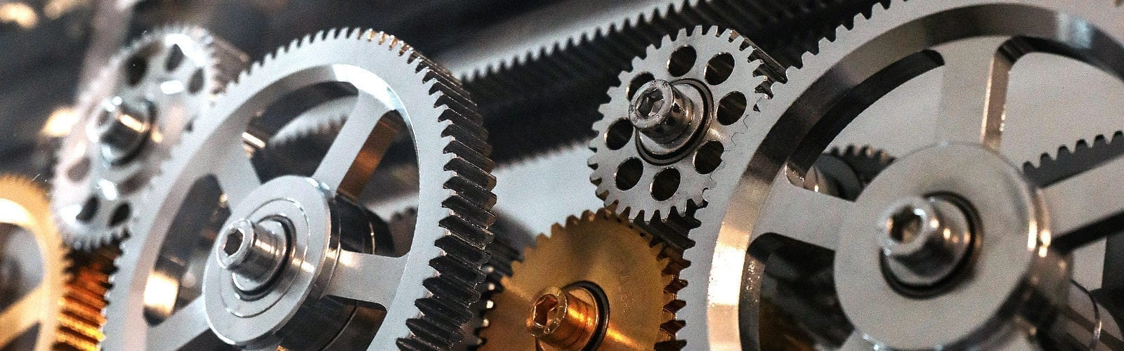 small and large silver and brass mechanical gears operating desk of founder Randy Garcia